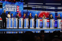 Democratic presidential candidates from left, Sen. Cory Booker, D-N.J., Rep. Tulsi Gabbard, D-Hawaii, Sen. Amy Klobuchar, D-Minn., South Bend, Ind., Mayor Pete Buttigieg, Sen. Elizabeth Warren, D-Mass., former Vice President Joe Biden, Sen. Bernie Sanders, I-Vt., Sen. Kamala Harris, D-Calif., former technology executive Andrew Yang and investor Tom Steyer participate in a Democratic presidential primary debate, on Nov. 20, 2019, in Atlanta. (AP Photo/John Bazemore)