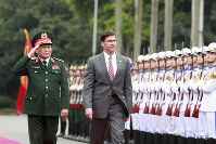 U.S. SDefense Secretary Mark Esper, right, and Vietnamese Defense Minister Ngo Xuan Lich review an honor guard in Hanoi, Vietnam, on Nov. 20, 2019. (AP Photo/Hau Dinh)