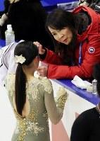 Japan's Rika Kihira, foreground, is seen speaking with her coach, Mie Hamada, during a practice session ahead of the ISU Grand Prix of Figure Skating NHK Trophy, on Nov. 21, 2019, at Makomanai Sekisuiheim Ice Arena in Sapporo. (Mainichi/Taichi Kaizuka)