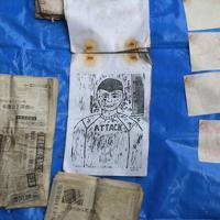 約35年ぶりに開けたタイムカプセルの中から出された版画や新聞=福島県双葉町で2019年11月22日午前11時33分、和田大典撮影
