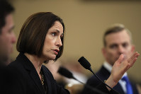 Former White House national security aide Fiona Hill, and David Holmes, a U.S. diplomat in Ukraine, right, testify before the House Intelligence Committee on Capitol Hill in Washington, on Nov. 21, 2019, during a public impeachment hearing of President Donald Trump's efforts to tie U.S. aid for Ukraine to investigations of his political opponents. (AP Photo/Manuel Balce Ceneta)