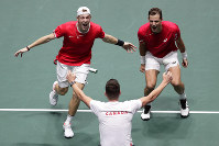 Canada's Vasek Pospisil, right, and Denis Shapovalov celebrate after winning against Australia's John Peers and Jordan Thompson during their Davis Cup double tennis match in Madrid, Spain, on Nov. 21, 2019. (AP Photo/Manu Fernandez)
