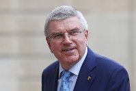 In this June 7, 2019 photo, International Olympic Committee (IOC) president Thomas Bach arrives to meet French President Emmanuel Macron at the Elysee Palace in Paris. (AP Photo/Francois Mori)