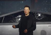 In this Nov. 21, 2019 file photo, Tesla CEO Elon Musk introduces the Cybertruck at Tesla's design studio in Hawthorne, Calif. (AP Photo/Ringo H.W. Chiu)