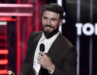 This May 20, 2018 file photo shows Sam Hunt accepting the award for top country song for