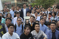 Newly-elected pro-democracy district council members chant slogans as they gather near Polytechnic University in Hong Kong, on Nov. 25, 2019. (AP Photo/Kin Cheung)