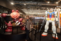 Toru Furuya, a voice actor who played main character Amuro Ray in the popular animated TV series Mobile Suit Gundam, is seen with replica statues of characters from the anime at an event held the day before the opening of the Narita Anime Deck entertainment facility at Narita International Airport in Chiba Prefecture, on Nov. 27, 2019. (Mainichi/Tadakazu Nakamura)