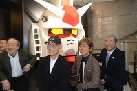 Toru Furuya, second from right, a voice actor who played main character Amuro Ray in the popular animated TV series Mobile Suit Gundam, and Yoshiyuki Tomino, third from right, creator of the anime franchise, are seen smiling at an event held the day before the opening of the Narita Anime Deck entertainment facility at Narita International Airport in Chiba Prefecture, on Nov. 27, 2019. (Mainichi/Tadakazu Nakamura)
