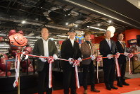 Toru Furuya, third from left, a voice actor who played main character Amuro Ray in the popular animated TV series Mobile Suit Gundam, and Yoshiyuki Tomino, second from left, creator of the anime franchise, are seen cutting the ribbon at an event held the day before the opening of the Narita Anime Deck entertainment facility at Narita International Airport in Chiba Prefecture, on Nov. 27, 2019. (Mainichi/Tadakazu Nakamura)