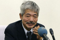 In this Aug. 28, 2008, file photo, Tetsu Nakamura, who headed the Japanese charity, Peace Medical Service, speaks during a press conference about the killing of the Japanese aid worker Kazuya Ito, at the Japanese embassy in Kabul, Afghanistan. (AP Photo/Musadeq Sadeq)