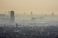 In this March 14, 2014 file photo, a layer of smog covers the city of Brussels. (AP Photo/Geert Vanden Wijngaert)