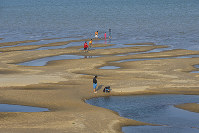 In this Dec. 4, 2019, photo, sightseers play on a sandbar in the Mekong River in Nakhon Phanom province, northeastern Thailand. (AP Photo/Chessadaporn Buasai)