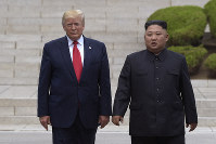 In this June 30, 2019, file photo, President Donald Trump, left, meets with North Korean leader Kim Jong Un at the North Korean side of the border at the village of Panmunjom in Demilitarized Zone. (AP Photo/Susan Walsh)
