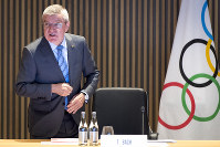 International Olympic Committee (IOC) president Thomas Bach from Germany speaks at the opening of the executive board meeting of the International Olympic Committee (IOC), at the Olympic House, in Lausanne, Switzerland, on Dec. 3, 2019. (Laurent Gillieron/Keystone via AP)