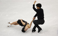 China's Wenjing Sui and Cong Han compete in the pairs short program during the figure skating Grand Prix finals at the Palavela ice arena, in Turin, Italy, on Dec. 5, 2019. (AP Photo/Antonio Calanni)
