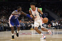 Washington Wizards forward Rui Hachimura (8), of Japan, dribbles the ball as he is defended by Philadelphia 76ers forward James Ennis III (11) during the second half of an NBA basketball game on Dec. 5, 2019, in Washington. The Wizards won 119-113. (AP Photo/Nick Wass)