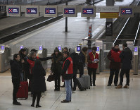 Railway employees, with red jackets, give informations to travellers at the Gare de Lyon train station, on Dec. 6, 2019 in Paris. (AP Photo/Rafael Yaghobzadeh)