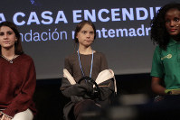 Climate activist Greta Thunberg arrives for a press conference in Madrid, on Dec. 6, 2019. (AP Photo/Bernat Armangue)