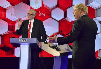 Opposition Labour Party leader Jeremy Corbyn, left, and Britain's Prime Minister Boris Johnson, during a head to head live Election Debate at the BBC TV studios in Maidstone, England, on Dec. 6, 2019. ( Jeff Overs/BBC via AP)