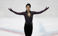 Japan's Yuzuru Hanyu celebrates after competing in the men's free skating during the figure skating Grand Prix finals at the Palavela ice arena, in Turin, Italy, on Dec. 7, 2019. (AP Photo/Antonio Calanni)
