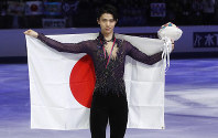 Japan's Yuzuru Hanyu celebrates after taking the second place at the men's free skating during the figure skating Grand Prix finals at the Palavela ice arena, in Turin, Italy, on Dec. 7, 2019. (AP Photo/Antonio Calanni)