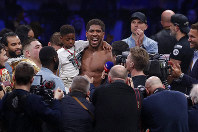 Britain's Anthony Joshua celebrates after beating Andy Ruiz Jr. to win their World Heavyweight Championship contest at the Diriyah Arena, Riyadh, Saudi Arabia early Sunday Dec. 8, 2019. (AP Photo/Hassan Ammar)