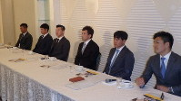 The Fukuoka SoftBank Hawks' Nobuhiro Matsuda, fourth from left, and other players from the Nippon Professional Baseball Organization's 12 teams gather at a regular Japan Professional Baseball Players Association union meeting in Osaka's Chuo Ward, on Dec. 5, 2019. (Mainichi/Kenji Denda)