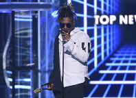 In this May 1, 2019 file photo, Juice WRLD accepts the award for top new artist at the Billboard Music Awards at the MGM Grand Garden Arena in Las Vegas. (Photo by Chris Pizzello/Invision/AP)