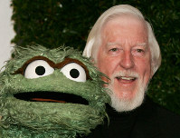 In this April 27, 2006 file photo, Caroll Spinney, right, who portrays