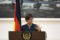 German Defense Minister Annegret Kramp-Karrenbauer speaks during a joint press conference, in Kabul, Afghanistan, on Dec. 3, 2019. (AP Photo/Rahmat Gul)
