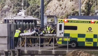 In this image made from video, injured from White Island volcanic eruption are ferried into waiting ambulances in Whakatane, New Zealand, on Dec. 9, 2019. (Katee Shanls/NZME via AP)