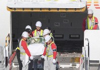 The coffin carrying the body of Japanese doctor Tetsu Nakamura arrives at Fukuoka Airport on Dec. 9, 2019. (Mainichi/Toyokazu Tsumura)