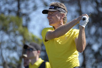 Bernhard Langer, front, of Germany, tees off on the eighth hole as his son, Jason Donald Langer, watches during the first round of the Father Son Challenge golf tournament on Dec. 7, 2019, in Orlando, Fla. (AP Photo/Phelan M. Ebenhack)