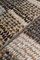 Puffer fish fins are seen arranged on sheets of plywood to dry in the sun and wind along the Kanmon Strait in the western Japan city of Shimonoseki, Yamaguchi Prefecture, on Dec. 4, 2019. (Mainichi/Takashi Kamiiriki)