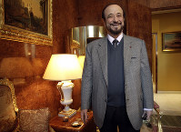 In this Nov. 15, 2011 file photo, Rifaat al-Assad, the uncle of Syrian President Bashar al-Assad, poses for a photographer in Paris. (AP Photo/Michel Euler)
