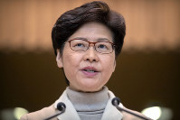 Hong Kong Chief Executive Carrie Lam speaks during a press conference at the Legislative Council in Hong Kong, on Dec. 10, 2019. (AP Photo/Mark Schiefelbein)
