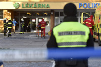 Firefighters, police officers and paramedics are seen in front of the Ostrava Teaching Hospital, after a shooting incident in Ostava, Czech Republic, on Dec. 10, 2019. (Jaroslav Ozana/CTK via AP)