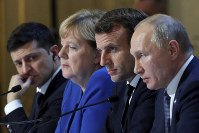 Ukraine's President Volodymyr Zelenskiy, left, German Chancellor Angela Merkel, French President Emmanuel Macron, third left and Russian President Vladimir Putin, right, attend a joint news conference at the Elysee Palace in Paris, on Dec. 9, 2019. (Charles Platiau/Pool via AP)