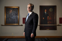 FBI Director Christopher Wray poses for a photo after an interview with The Associated Press, on Dec. 9, 2019, in Washington. (AP Photo/Jacquelyn Martin)