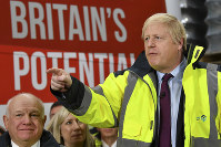Britain's Prime Minister Boris Johnson talks during a question and answer session, part of a General Election campaign visit to Ferguson's Transport in Washington, England, on Dec. 9, 2019. Britain goes to the polls on Dec. 12. (Ben Stansall/Pool Photo via AP)