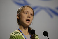 Swedish climate activist Greta Thunberg addresses a plenary of the U.N. climate conference during a meeting with leading climate scientists at the COP25 summit in Madrid, Spain, on Dec. 11, 2019. (AP Photo/Paul White)