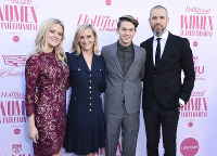 Ava Phillippe, from left, Reese Witherspoon, Deacon Phillippe and Jim Toth arrive at The Hollywood Reporter's Women in Entertainment Breakfast Gala on Dec. 11, 2019, in Los Angeles. (Photo by Jordan Strauss/Invision/AP)
