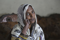 In this April 14, 2019 photo, Pakistani Christian woman Samiya David talks to the Associated Press, in Gujranwala, Pakistan. Samiya had been in China just two months when her brother got a phone call telling him to pick her up at the airport. When he arrived, he found Samiya in a wheelchair, malnourished and too weak to walk, said her cousin Pervaiz Masih. She died barely five weeks later. (AP Photo/K.M. Chaudary)