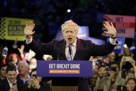 Britain's Prime Minister Boris Johnson speaks during his ruling Conservative Party's final election campaign rally at the Copper Box Arena in London, on Dec. 11, 2019. (AP Photo/Kirsty Wigglesworth)
