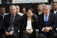 In this Sept. 19, 2019 file photo, Blue and White party leader Benny Gantz, left, Esther Hayut, the Chief Justice of the Supreme Court of Israel, center, and Israeli Prime Minister Benjamin Netanyahu attend a memorial service for former President Shimon Peres in Jerusalem. (AP Photo/Ariel Schalit)