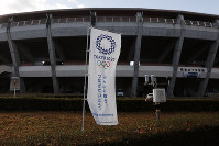 A Tokyo 2020 banner stands in front of the Azumi Baseball Stadium, a venue for baseball and softball at the Tokyo 2020 Olympics, in Fukushima, Fukushima Prefecture, on Nov. 30, 2019. (AP Photo/Jae C. Hong)