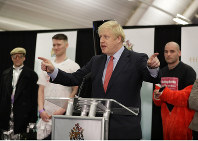 Britain's Prime Minister and Conservative Party leader Boris Johnson gestures as he speaks after the Uxbridge and South Ruislip constituency count declaration at Brunel University in Uxbridge, London, on Dec. 13, 2019. (AP Photo/Kirsty Wigglesworth)