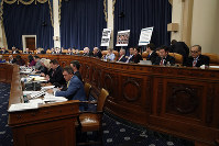 Members of the committee work into the night during a U.S. House Judiciary Committee markup of the articles of impeachment against President Donald Trump, on Capitol Hill on Dec. 12, 2019, in Washington. (AP Photo/Alex Brandon)