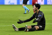 Salzburg's Takumi Minamino reacts during the group E Champions League soccer match between Salzburg and Liverpool, in Salzburg, Austria, Tuesday, Dec. 10, 2019. (AP Photo/Kerstin Joensson)