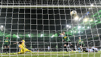 Basaksehir's Enzo Crivelli scores their decisive second goal against Moenchengladbach's goalkeeper Yann Sommer during the Europa League Group J soccer match between Borussia Moenchengladbach and Istanbul Basaksehir in Moenchengladbach, Germany, on Dec. 12, 2019. Borussia was defeated by Basaksehir with 1-2. (AP Photo/Martin Meissner)